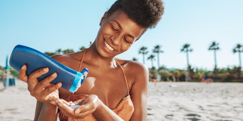 woman-sunbathing-at-the-beach
